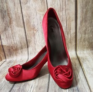 Red satin shoes with rosette